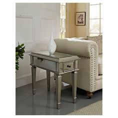 Mirrored Side Table - Silver. End of couch