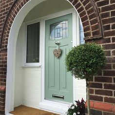 Pretty front door with slight overhang to allow you to shelter from the rain. Pretty front door with slight overhang to allow you to shelter from the rain. Front Door Overhang, Front Door Porch, Green Front Doors, Porch Doors, Front Door Signs, Front Door Entrance, Exterior Front Doors, House Front Door, Front Door Colors