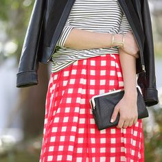 Modernize a '50s-inspired skirt with a black leather jacket. #StylistTip