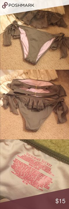Bikini Victoria Secret Army Green Ruffle Bikini ✨ in great condition, is missing straps to top that gave it the option to tie around the neck.. is still wearable with out them they just came with it for a option! I never used them, Top is a size Small, Bottoms are a size Medium. Looks super cute on! The color looks great with a tan! ✨ Victoria's Secret Swim Bikinis