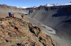 Scientist above Don Juan Pond, McMurdo Dry Valleys, Antarctica (© Colin Harris/era-images/Alamy)