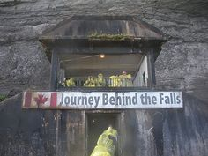 Behind Niagra Falls.  There was a famous ledge that provided a spectator view.  The Falls eroded and the ledge fell off.  Now you stand inside the tunnel and look out at the Falls falling in front of you.