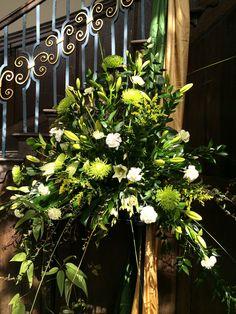 Church flower pedestal arrangement by Flower Buds