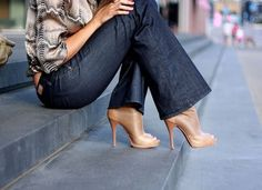 Dark boot cut jeans and heels.