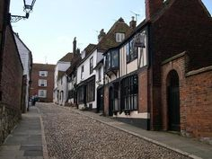 One of the steep cobblestone streets in Rye, England that used to lead straight down to the harbor. Best Travel Deals, Travel Tips, Maybe Someday, East Sussex, England Uk, Places Ive Been, United Kingdom, To Go, Europe