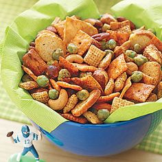 Touchdown Party Mix - Easy Snack Mix from MyRecipes.com - OR (for my favorite) just mix together bags of Chex Mix, M's, Mixed nuts, & Rice Crackers snacks. YUM!