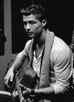 Cr7 with a guitar. Could he be any more perfect?