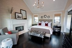 This master bedroom looks bright and airy with its light-colored walls and accent pieces.