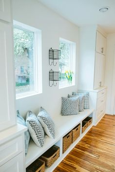 Fixer Upper-Pillows-baskets-bench under windows Magnolia House