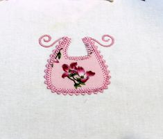 This darling design is a sample of our applique clothesline designs (coming soon!) Perfect for using up those fabric scraps you have been collecting! Suitable for baby blankets and quilts, onesies, and burp pads. Place an initial on the little bib for personalization.