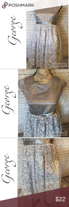 George girls silver formal dress, size 16 George girls silver formal dress with lace skirt, size 16. Lined dress, back buttons, tulle skirt.  Excellent used condition  NOTE:  Sale does not apply to formal wear, but please feel free to make an offer George Dresses Formal