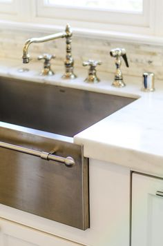 Evars and Anderson: Gorgeous apron stainless steel kitchen sink with towel bar. The apron sink pairs with a ...