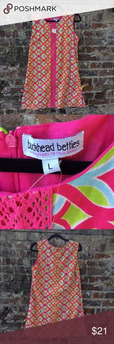 "NWT Buckhead Betties Tango Twist dress NWT Buckhead Betties Tango Twist Pink Camilla dress! Super cute with bright colors & bottom ties on each side. Size large, length 35"" from shoulder to hem & bust is 19"". Buckhead Betties Dresses"