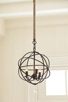 Update a chandelier -   Here's an instant improvement: Replace a cheap-looking hanging chain with a jute-wrapped pole that hides the cord—and looks a lot less fussy than a cover sleeve of bunched fabric. Available in three lengths, from about $40; ballarddesigns.com