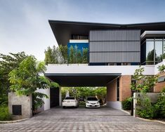 Two Houses Connected to Each Other for Two Brothers with Different Lifestyles is part of Architecture house - Bangkokbased Alchemist Architects have designed two houses, side by side, for two brothers with different lifestyles Modern Architecture House, Residential Architecture, Modern House Design, Interior Architecture, Garage Guest House, Modern Tropical House, Modern Bungalow, Storey Homes, Entrance Design