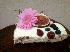 One last piece of a chocolate cake with cream made of sour cream, mascarpone and white chocolate