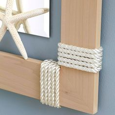 Rope-Wrapped Frame – Visually anchor a boring mirror with an easy, nautical-inspired frame. To make the frame, miter pine boards and join with wood glue. Tape the ends of the rope to prevent raveling, then glue one taped end to th Nautical Bathrooms, Beach Bathrooms, Costal Bathroom, Modern Bathroom, Beach House Decor, Diy Home Decor, Room Decor, Deco Marine, Boho Home