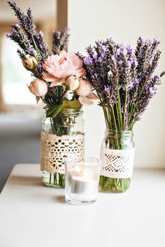 Relaxed lavender & peony wedding flowers as table decorations.