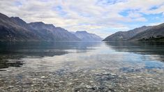 The view from the waterline at Kingston - Lake Wakatipu is framed by the Eyre Mountains to the left and the Hector Range to the right. https://handbooking.tech.blog