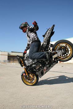 Learn motorcycle stunts ukm
