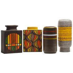 Group of Italian Ceramic Vases  Italy  c. 1960's  Collection of mid-century Italian ceramics with bright citrus glazes. Patterns in yellow, orange, and lime pop against earth tones. Cylinder vase with incised yellow band is Bitossi for Raymor; the other three are Rosenthal Netter.