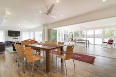 Check out this awesome listing on Airbnb: The Great House: lakefront, new - Houses for Rent in Godfrey Beach Houses For Rent, Screened In Porch, Wall Oven, Renting A House, Great Places, New Homes, Dining Table, Cottage, Kitchen