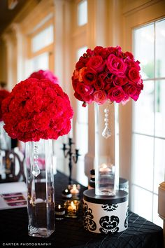 carnation and rose spheres on tall vases with a chic touch: hanging crystals