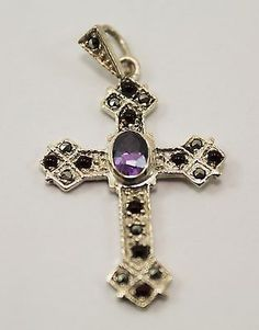 Sterling Silver Cross Pendant w/ 9 garnets, 1 amethyst and 10 marcasites