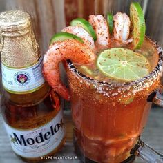 CEVICHE MICHELADA  Modelo Beer Camaronazo Juice  Lime Juice  Lemon Juice  Bitters  Tapatio Hot Sauce (Ceviche) shrimp , cucumber , avocado , cilantro , cherry tomatoes  Instagram Photo Credit: @calimixers  Videos: www.youtube.com/TipsyBartender Pictures: www.Instagram.com/TipsyBartender Snapchat: TipsyBartender  www.twitter.com/TipsyBartender  www.pinterest.com/TipsyBartender  #beer #michelada #cocktail #drink #summer