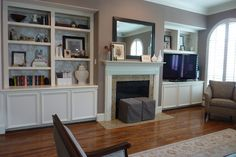These built in bookcases would almost work in my living room around the fireplace; there are windows on either side though