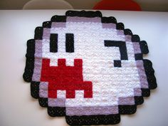 """Yes, it is a 30"""" Super Mario Boo Crochet Blanket. (USD 45.00), via AtomicBits at Etsy."""