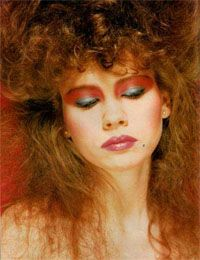 """blue and pink eyeshadow and a """"wet look"""" spiral perm were The look in middle school"""