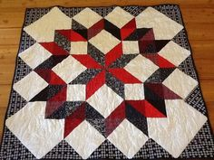 "Red, white and black quilt from Teresa Decker Owens: ""carpenter star made for a golf tournament raffle."""