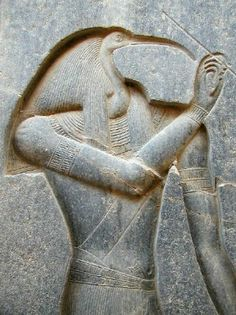 "Thoth: ""the god of wisdom, inventor of writing, patron of scribes and the divine mediator. He is most often represented as a man with the head of an ibis, holding a scribal palette and reed pen. He could also be shown completely as an ibis or a baboon, a Lunar aspect."