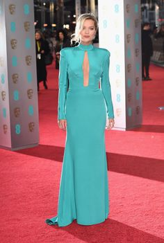 Laura Whitmore, a British TV personality, went for a long-sleeved teal gown with a high neckline and shoulder pads. She still showed some skin, though, with a major vertical cutout down the middle of her torso. (Photo by Ian Gavan/Getty Images)                                     via @AOL_Lifestyle Read more: http://www.aol.com/article/2016/02/15/2016-bafta-award-winners-the-complete-list/21312692/?a_dgi=aolshare_pinterest#slide=3798301|fullscreen