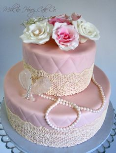 Elegant Bridal Shower Cake - All edible, including isomalt butterfly brooch and sugarveil lace. Top tier is pink champagne with raspberry cream and bottom tier is mocha with caramel cream. Iced with white chocolate ganache under fondant. TFL!