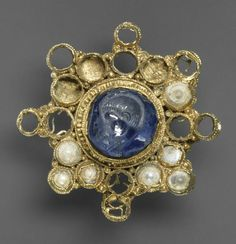Star-Shaped Brooch with Intaglio (second half of 10th century (setting); intaglio A.D. 337-350); Star sapphire, pearls, gold; Overall: Diam. 4 11/16 x 3/4 in. (11.9 x 1.9 cm)