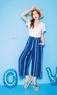 Give your casual look a retro spin with these hip, Wide Leg High Rise Striped Pants.