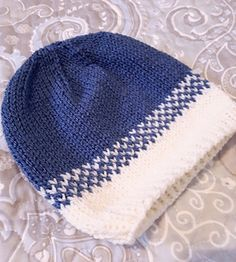 This is a simple fast to knit hat for a newborn baby. It's knit on the round and uses two colors. It doesn't require much yarn so it's perfect for using leftover yarn in your stash.