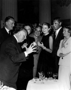 "Grace Kelly, Cary Grant, Alfred Hitchcock, John Williams, Jessie Royce Landis and others. Cocktail Party given by Alfred Hitchcock for Film ""To catch a Thief"". Cannes, 1954"