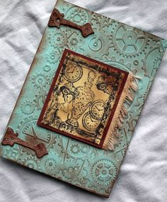 steampunk card.  I love the background and the hinges.  I would change the center piece