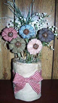 Spring fabric flowers - love the jingle  bells for the center
