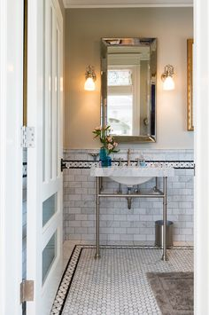 undermount sink with a marble top on console legs | Remodeled ...