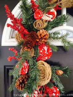 Holiday Wreath detail, using pine cones, burlap and red chevron fabric.