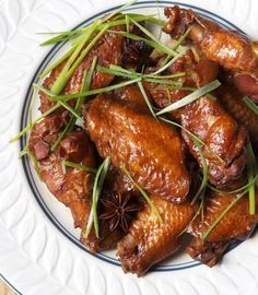 Soy Sauce Chicken recipe, featuring the added flavors of cinnamon, star anise, ginger and garlic. Garnish with chopped or shredded scallion for a pop of green. | recipe by Diane Kuan at the Appetite for China food blog