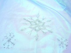 Cape for the Elsa dress I made for my niece -  snowflakes done with glitter puffy paint