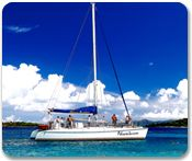 St. John Half Day Champagne Cat Sail - (ST82)    Sail to the island of St. John to swim, snorkel, beachcomb, or relax on the beach. Enjoy baked breads, cheeses, fruits, and champagne/other beverages.