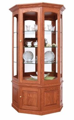 Make a breathtaking display with a Deluxe Glass Curio Cabinet from DutchCrafters. Pick from 3 styles, 6 wood types, lighting options, shelf selections and more! Glass Curio Cabinets, Glass Shelves, Cabinet Doors, White Oak Wood, Walnut Wood, Quarter Sawn White Oak, Hickory Wood, Vintage Plates, Types Of Wood