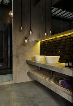 Vintage filament bulbs complements the industrial look of the bathroom.