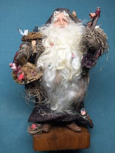"""Lindy Evans 17"""" OOAK old world Santa with birds. The expressive faces of Lindys designs are developed from studies of real people with no two Santas having the same features. Visit Lindy's website, www.lindyevans.co... to view a brief video on how she sculpts Santa's hands and faces."""